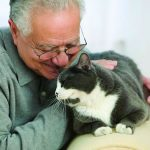 Mature man with pet cat