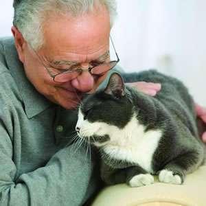 Mature man with pet cat