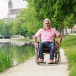 Man travelling in a wheelchair